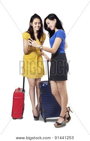 Two Female Travelers With Cellphone