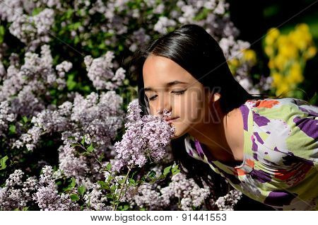 Little Girl Stop to Smell the Flowers