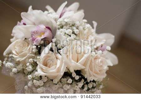 White roses and orchids in wedding bouquet