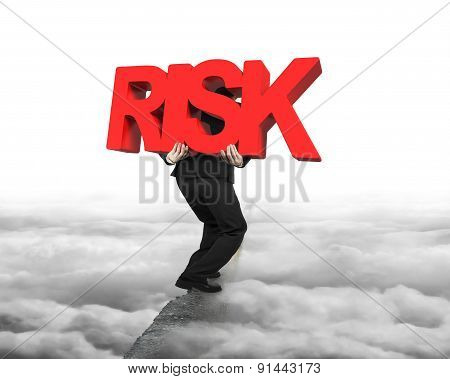 Man Carrying Red Risk Word On Ridge With Cloudscape Cityscape