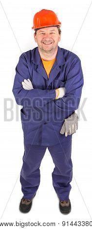 Worker in red protective helmet.