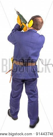 Worker standing with green drill.