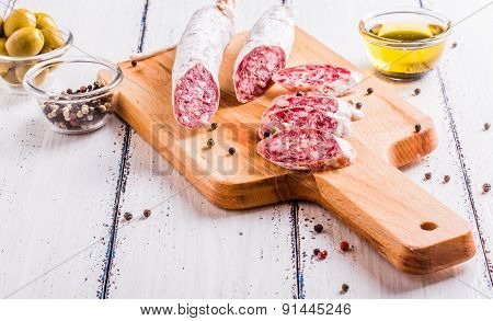 Slices Of Salami On A Cutting Board