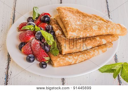 Homemade Crepes With Berries And Fruit