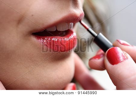Attractive Woman's Mouth With Fashion Red Lips Makeup