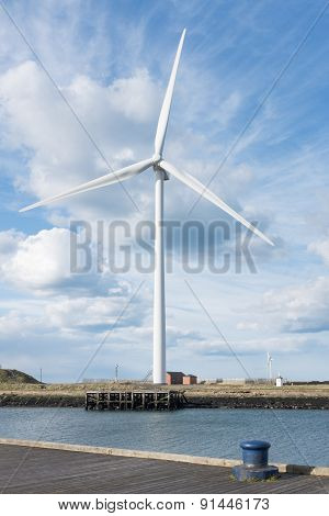 Blyth, Northumberland, UK, 27 April 2015. Wind turbine photographed against dramatic cloudy blue sky