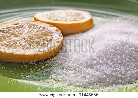 Citric acid and two slices of a lemon