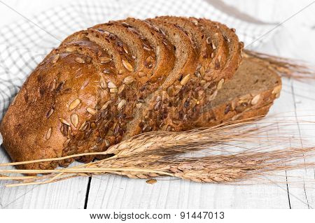 Sliced Bread With Sunflower Seeds And Ears Of Wheat
