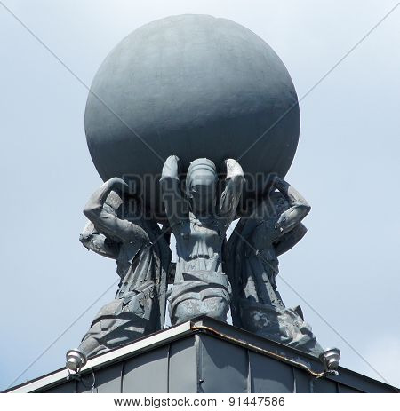 Statues Holding A Globe