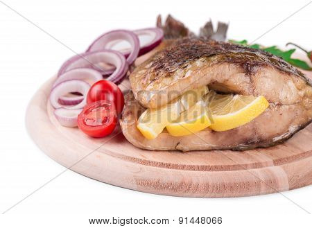 Fried carp tail with lemon and onion.
