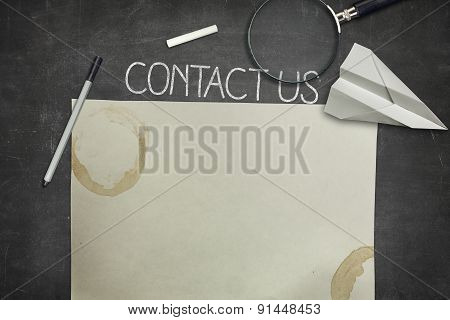 Contact us and blank application concept on black blackboard