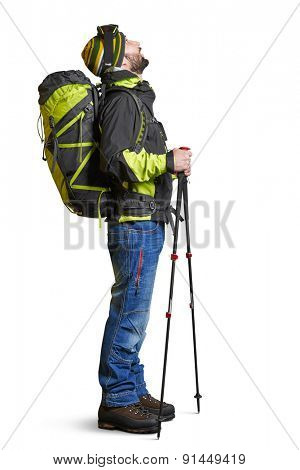 full length portrait of surprised hiker with backpack and hiking poles looking up with open mouth. isolated on white background
