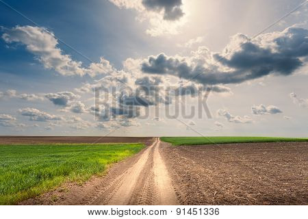 Driving On An Empty Dirt Road At Sunny Day