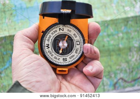 The Compass In His Hand Outdoors.
