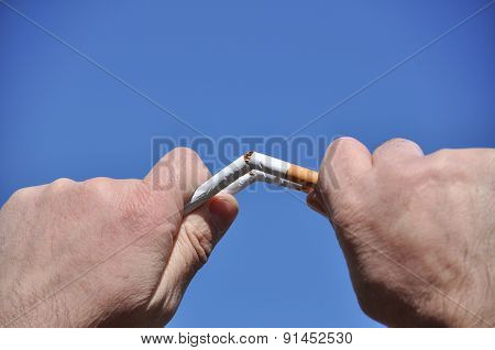 Broken Cigarette In Man's Hands
