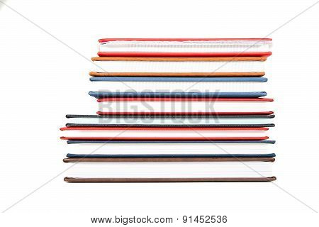 Stack Of Diaries On White Background