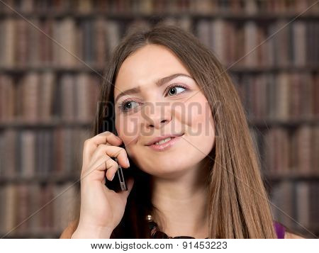 Female Student Talking On The Phone.