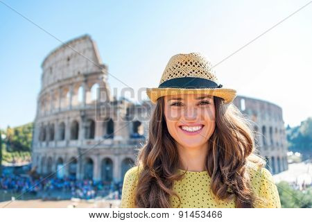 Portrait Of Smiling Woman At Colosseum In Rome In Summer