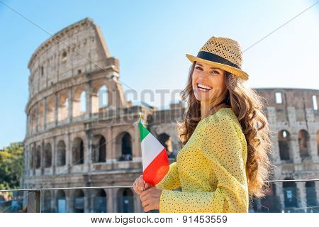 Woman Holding Flag And Smiling At Colosseum In Rome