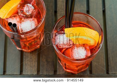 Top Of View Of Glasses Of Spritz Aperitif Aperol Red Cocktail With Orange Slices And Ice Cubes