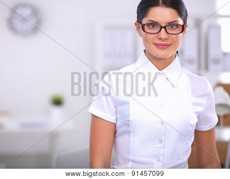 Portrait of a young woman working at office