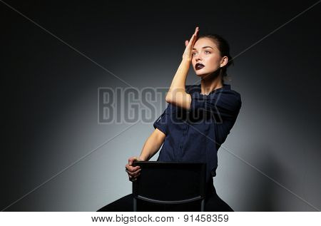 Portrait of beautiful young woman face. Isolated on black background.