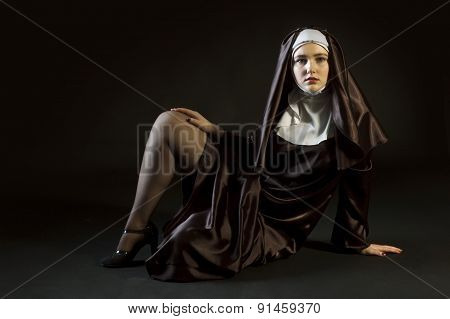 Nun Laying Exposing Leg