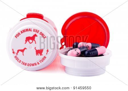 Animal medication with bottles, on white background