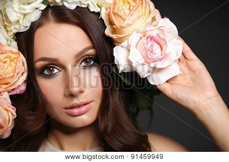 Portrait of a beautiful woman with flowers in her hair. Fashion.