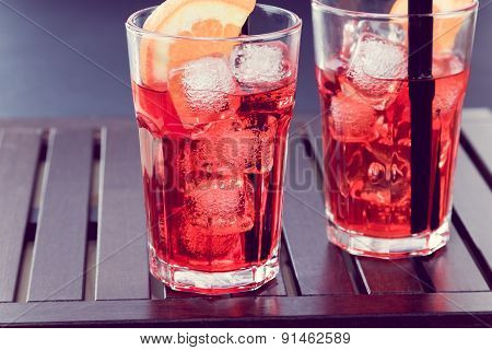Spritz Aperitif Aperol Cocktail With Two Orange Slices And Ice Cubes Vintage Style