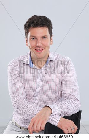 A handsome man standing isolated on white background.