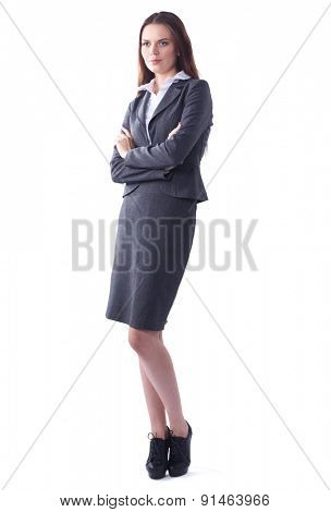 Attractive businesswoman standing in office  with crossed arms.