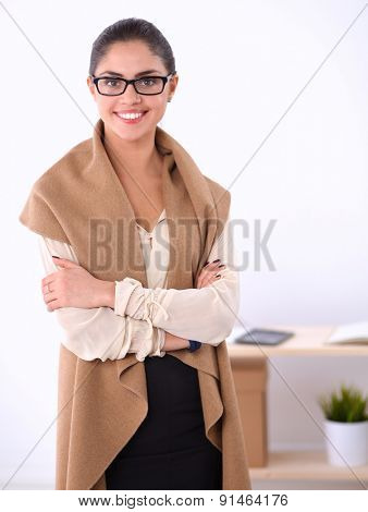 Portrait of beautiful business woman standing with folded arms, isolated on white background.