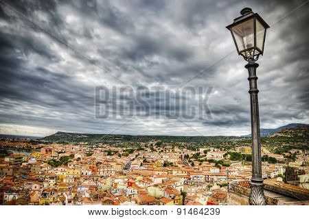 Lamppost Over Bosa Buildings On A Cloudy Day