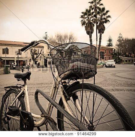 Old Bicycle Parked In An Italian Square