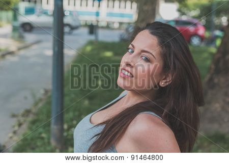 Portrait Of A Beautiful Curvy Girl Posing In An Urban Context