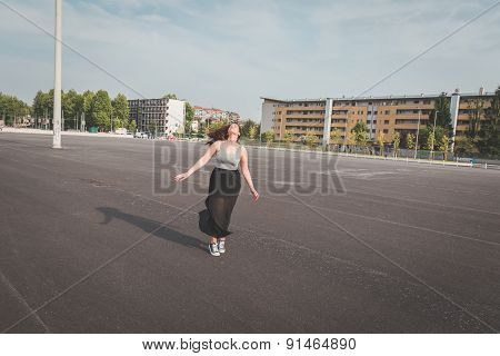 Beautiful Curvy Girl Posing In An Urban Context