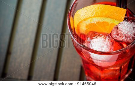 Top Of View Of Spritz Aperitif Aperol Cocktail Glass With Orange Slices And Ice Cubes