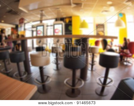 Defocused And Blurry Image Of The Interior Of A Fast Food Restaurant