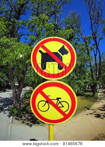 Prohibiting Signs No-dogs And No-bikes In The Park
