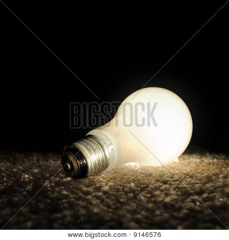 Unscrewed Glowing Light Bulb