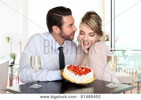 Happy Couple At The Bar With Sparkling Wine And Cake, Love Concept