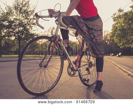 Woman On Bicycle At Sunset