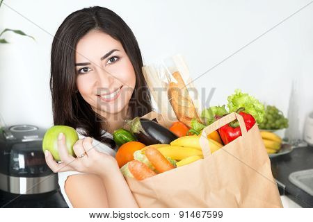 Brunet Woman Holding Paper Bag With Vegetarian Food