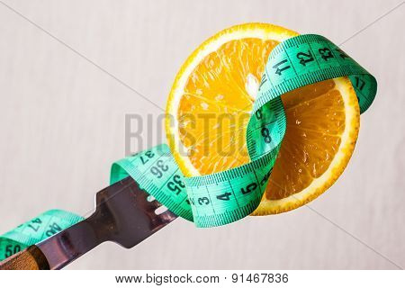 Green Measuring Tape And Orange Fruit