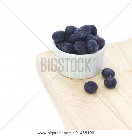 White bowl of blueberries