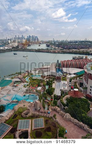 View of the Sentosa island and commercial port of Singapore with a bird eye view.