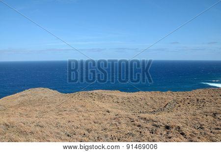 Curved Landscape Over Ocean