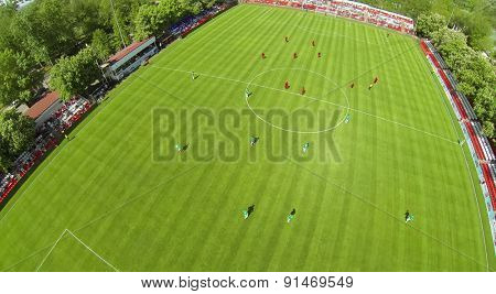 RUSSIA, BOGORODSKOE  - MAY 14, 2014: Aerial view of sportsmen attack gate on football field of Spartakovec stadium named by N.P. Starostin during international competition.