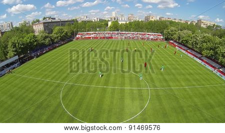 RUSSIA, BOGORODSKOE - MAY 14, 2014: Players attack gate on football field of Spartakovec stadium named by N.P. Starostin during international competition. Aerial view